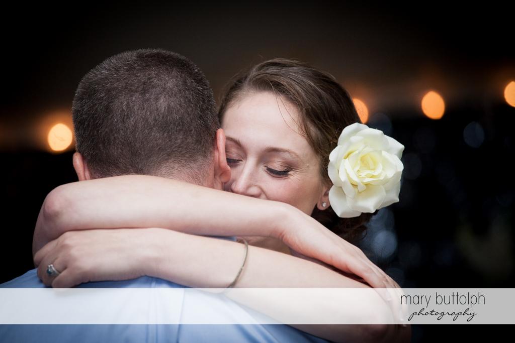 Couple embrace while dancing at Anyela's Vineyards Wedding