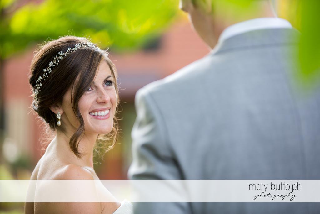 Bride smiles at the groom at Anyela's Vineyards Wedding