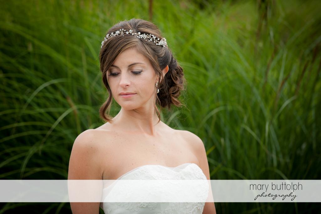 Bride poses in the garden at Anyela's Vineyards Wedding