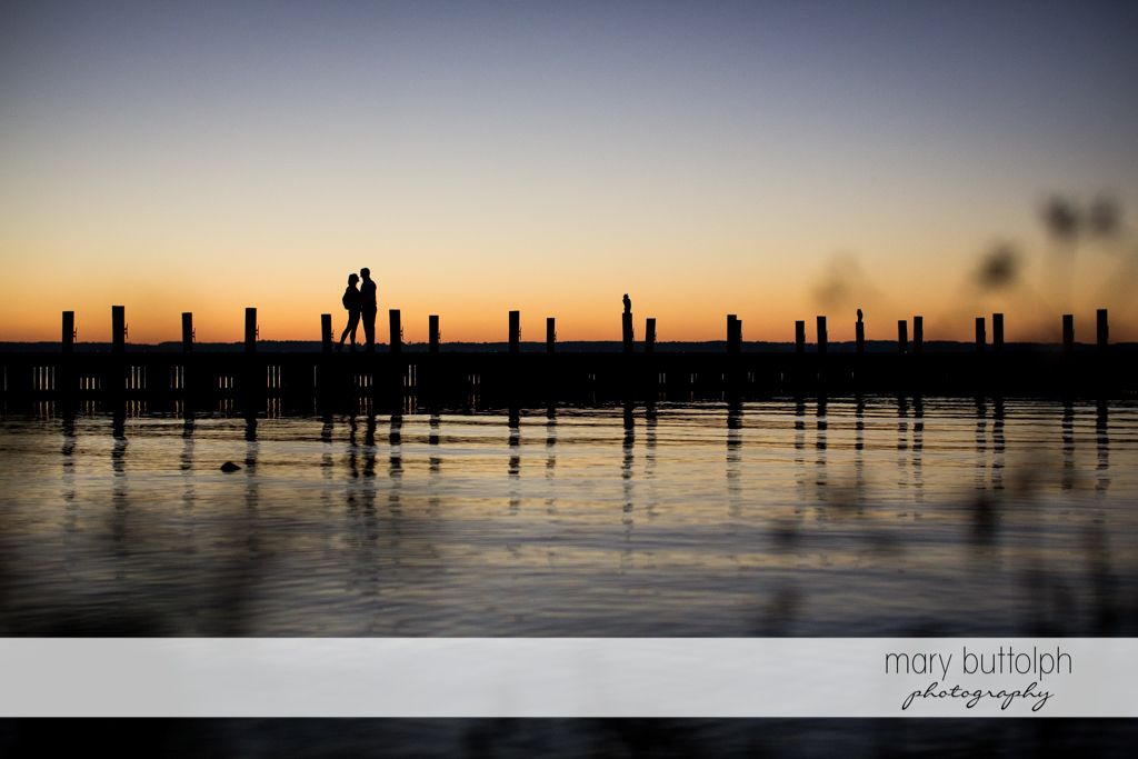 Couple stand by the lake at the Inns of Aurora Engagement