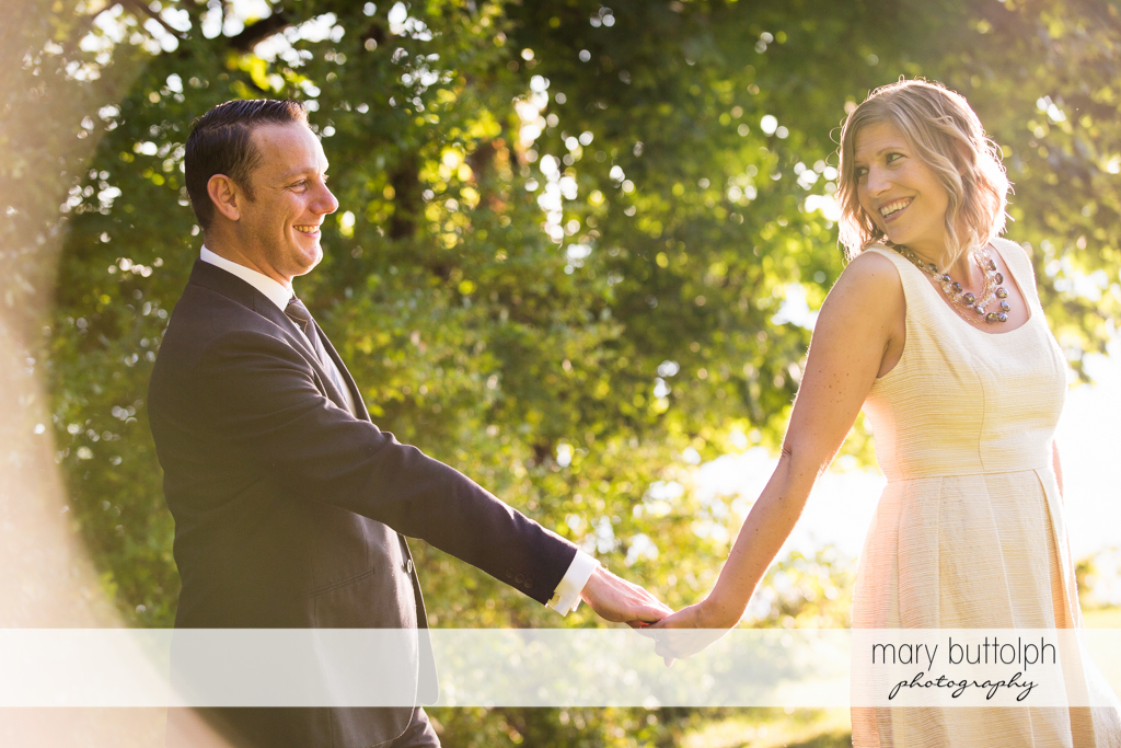 Couple stroll in the garden at the Inns of Aurora Engagement