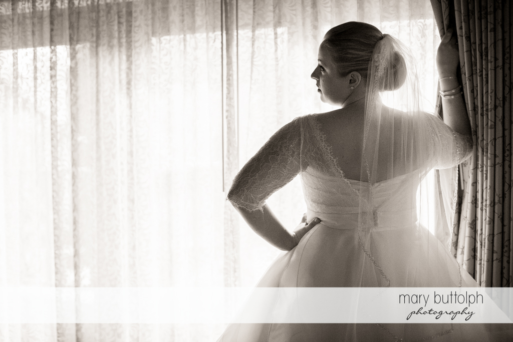 Bride faces the window at Skaneateles Country Club Wedding