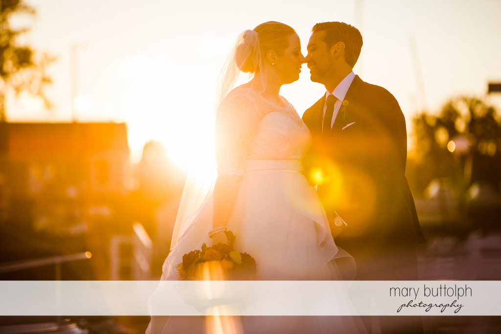 Couple catch the rays of the sun at Skaneateles Country Club Wedding
