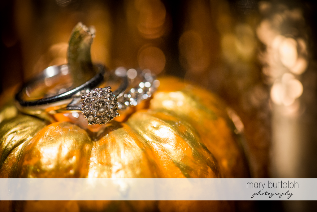 Couple's wedding rings at a candy pumpkin at Skaneateles Country Club Wedding