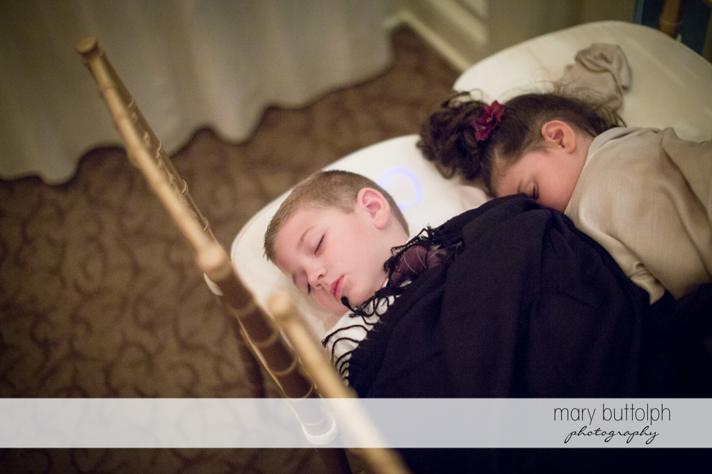 Young boy and girl take a nap at Skaneateles Country Club Wedding
