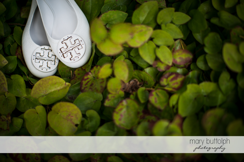 Close up shot of the bride's wedding shoes in the garden at Skaneateles Country Club Wedding