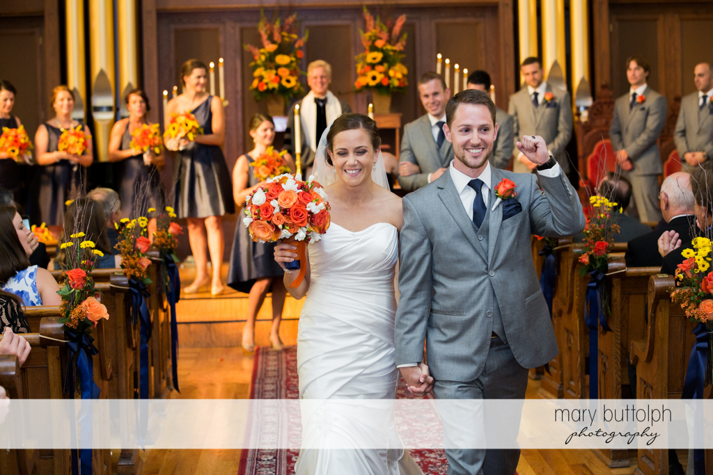 Couple leave the church after the wedding ceremony at Skaneateles Country Club Wedding
