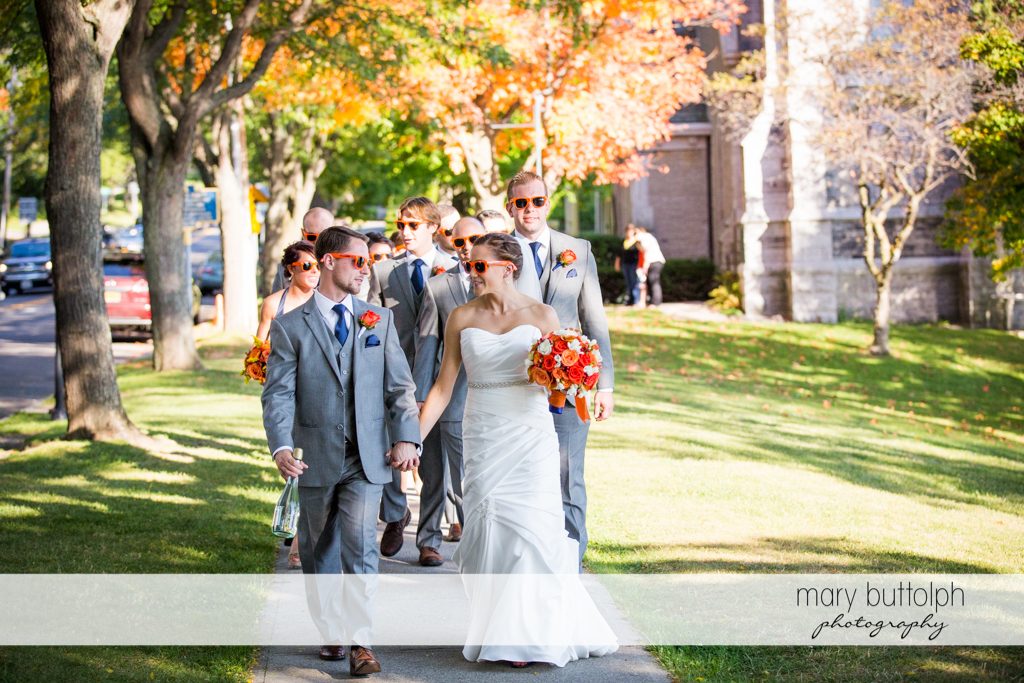 The wedding party take a stroll at Skaneateles Country Club Wedding