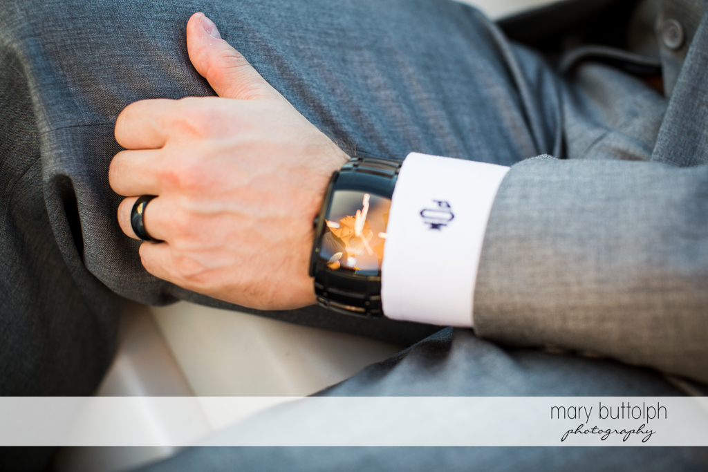 Close up shot of the groom's watch and wedding ring at Skaneateles Country Club Wedding