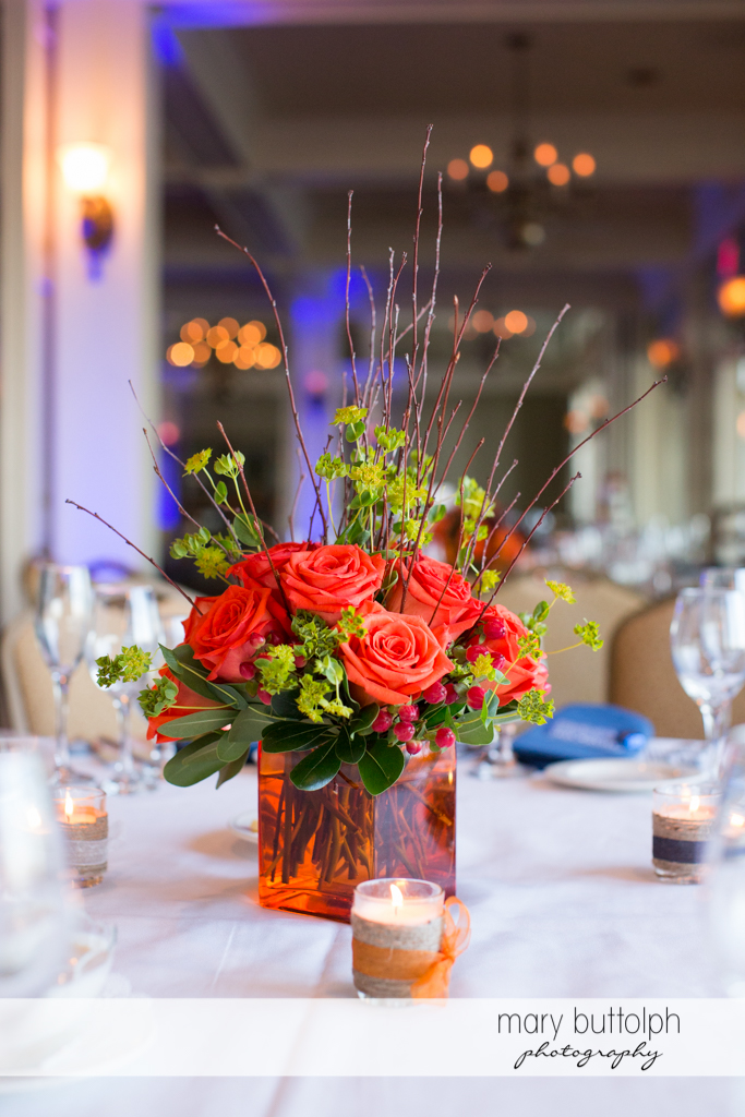 Flowers adorn the tables at the wedding venue at Skaneateles Country Club Wedding