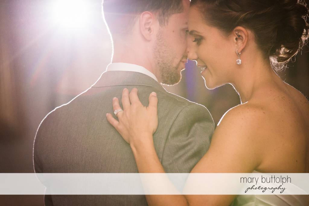 Couple share a tender moment at Skaneateles Country Club Wedding