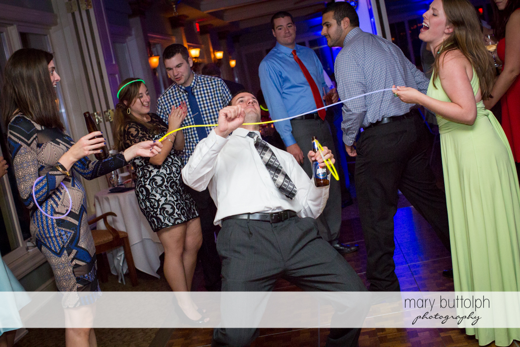 A guest dances the limbo at the wedding venue at Skaneateles Country Club Wedding