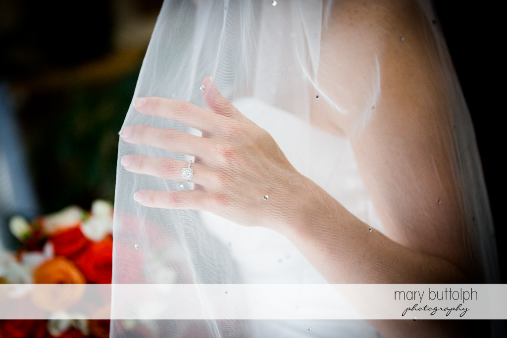 Bride's wedding ring is seen through her veil at Skaneateles Country Club Wedding