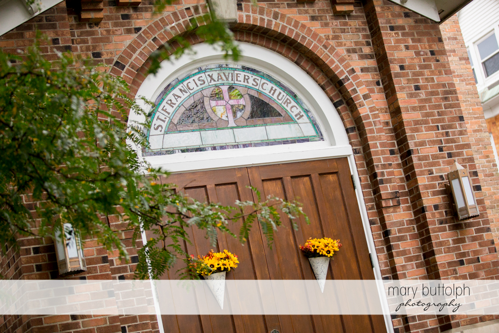 Stained glass window silently proclaims the name of the church at the Sherwood Inn Wedding