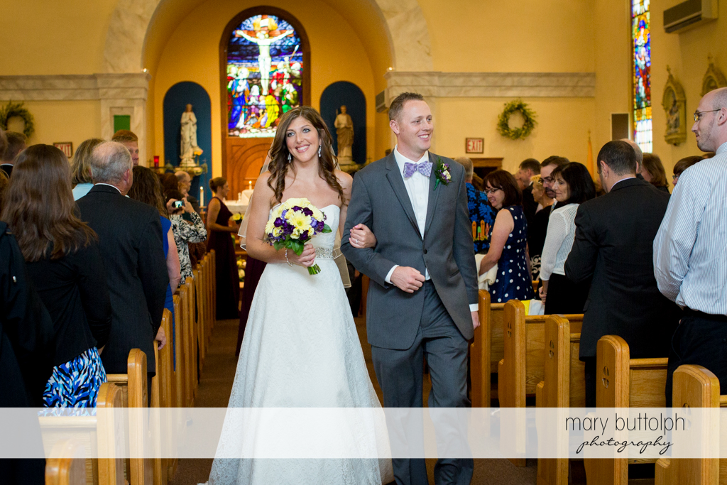 Couple leave the church as guests look on at the Sherwood Inn Wedding