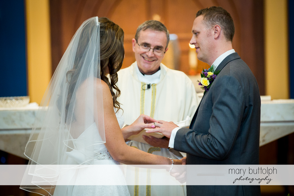 Happy priest faces the couple in front of the altar at the Sherwood Inn Wedding