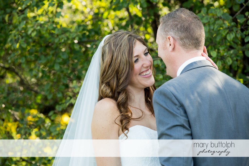 Couple face each other in the garden at the Sherwood Inn Wedding