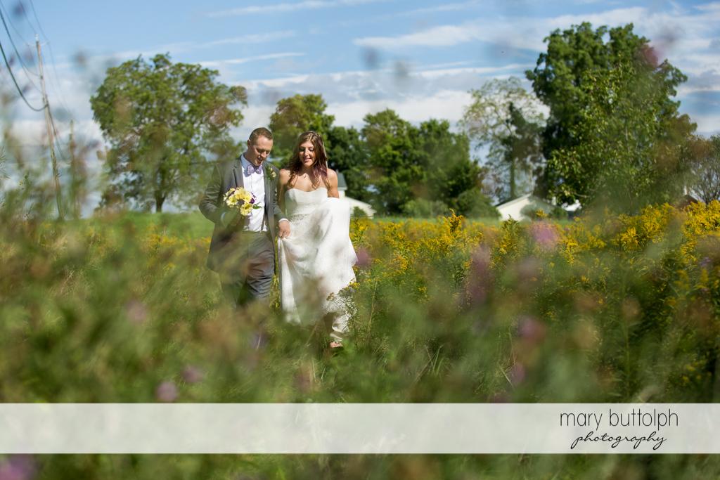 Couple stroll in the garden at the Sherwood Inn Wedding