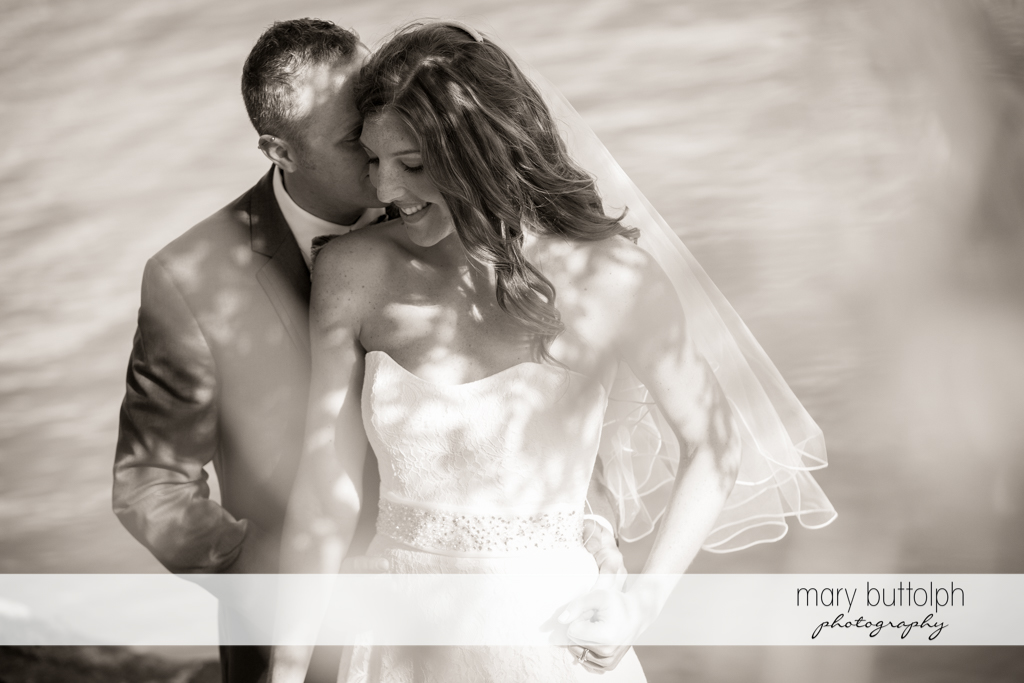 Couple share a tender moment by the lake at the Sherwood Inn Wedding