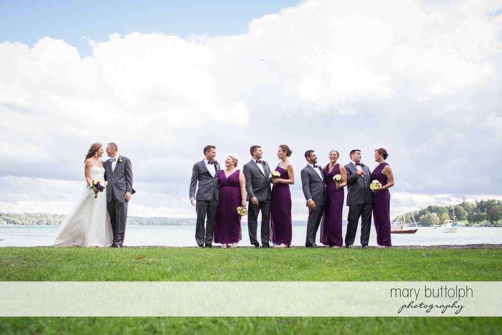 The wedding party stand in front of the lake at the Sherwood Inn Wedding