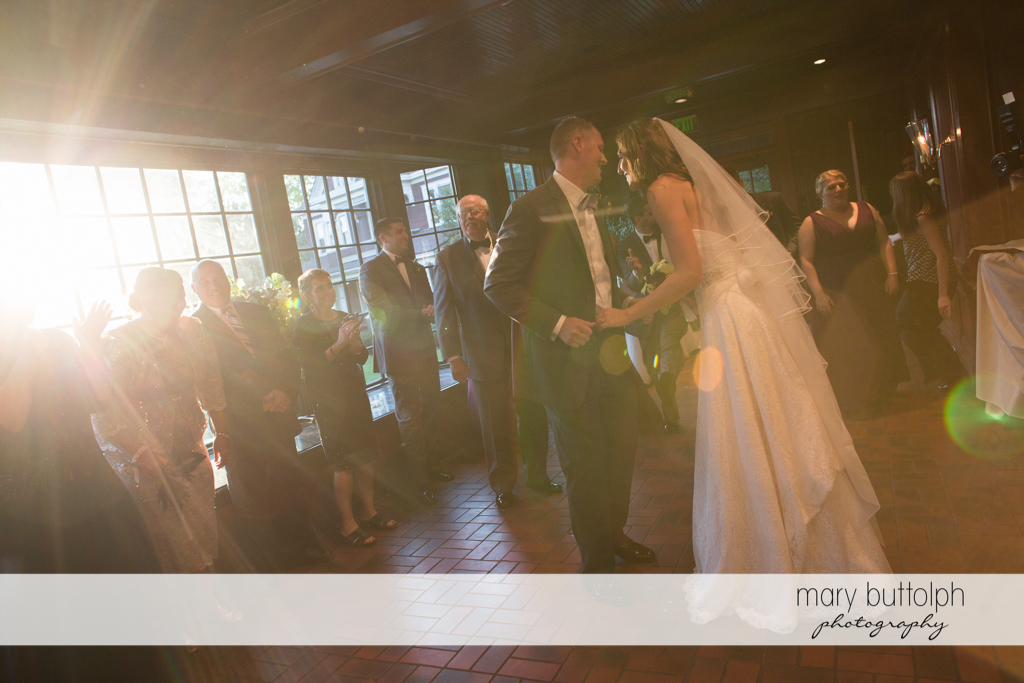 Couple dance in front of guests at the wedding venue at the Sherwood Inn Wedding