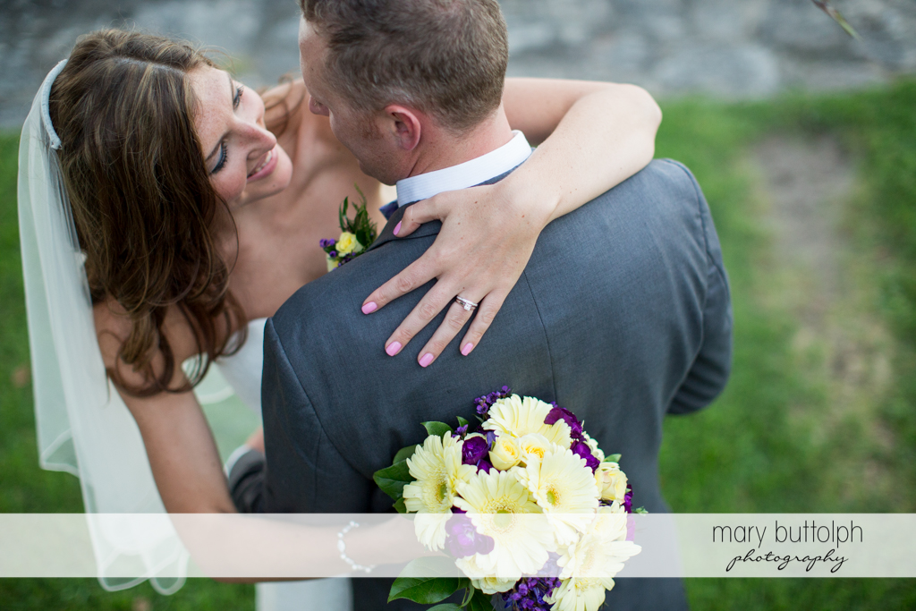 Couple embrace in the garden at the Sherwood Inn Wedding