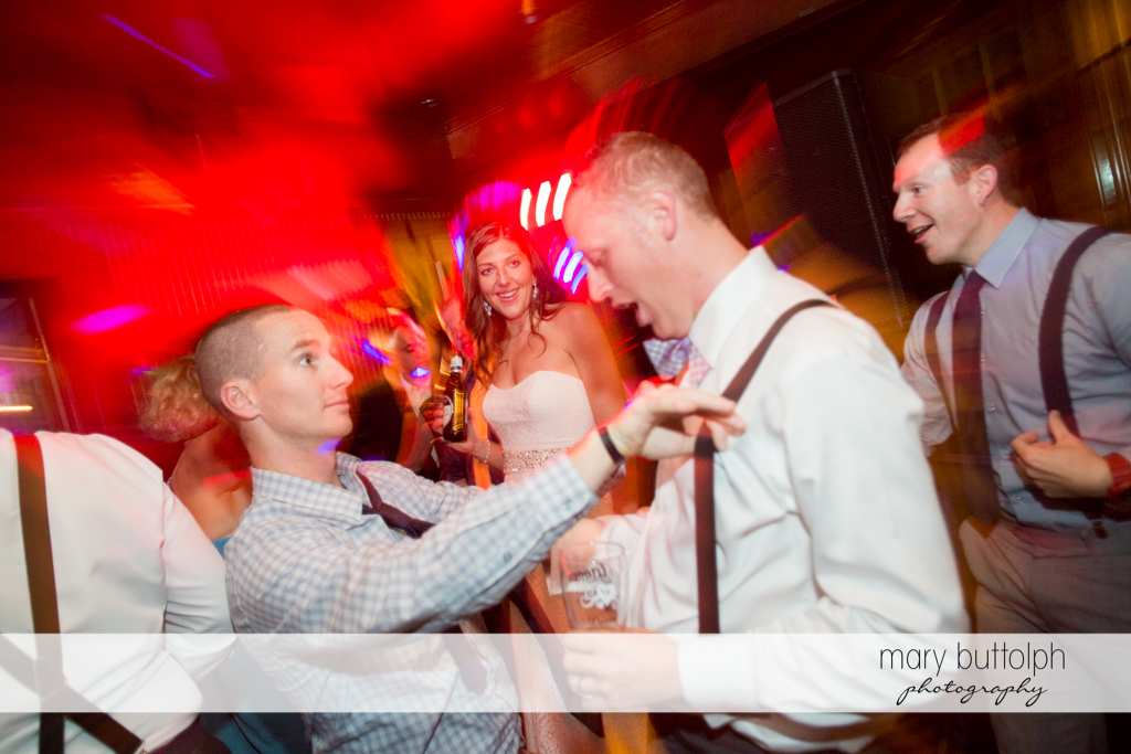 Guests clown around on the dance floor at the Sherwood Inn Wedding
