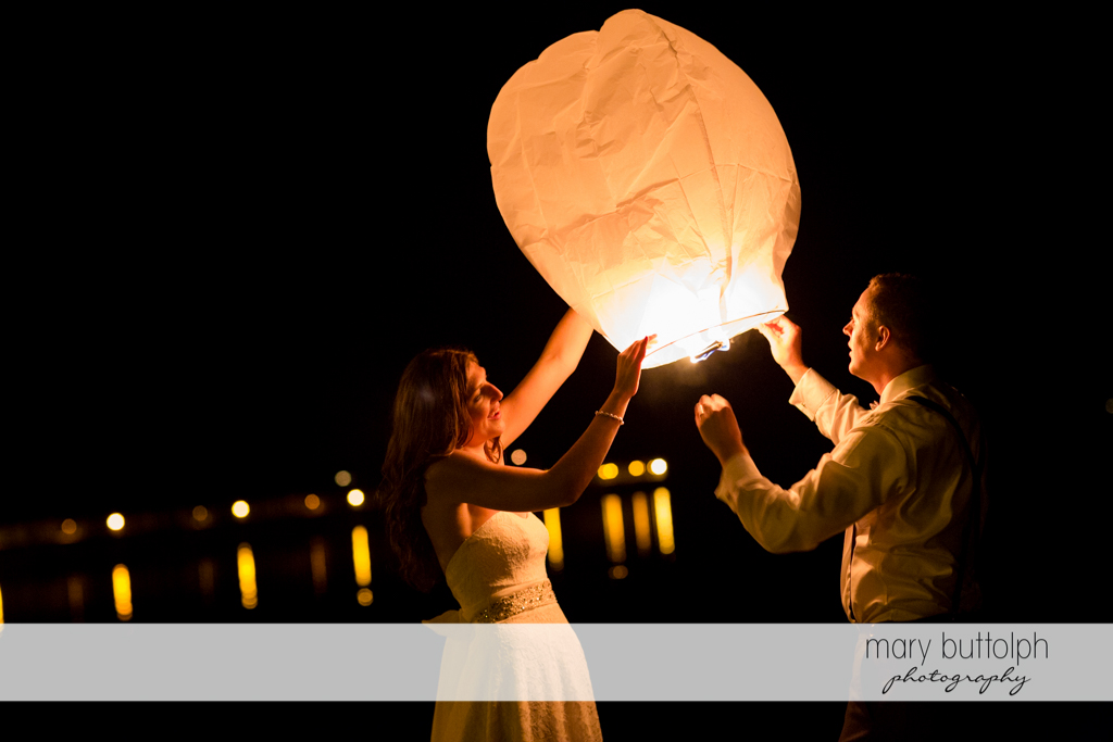 Couple prepare to release a paper lantern at the Sherwood Inn Wedding