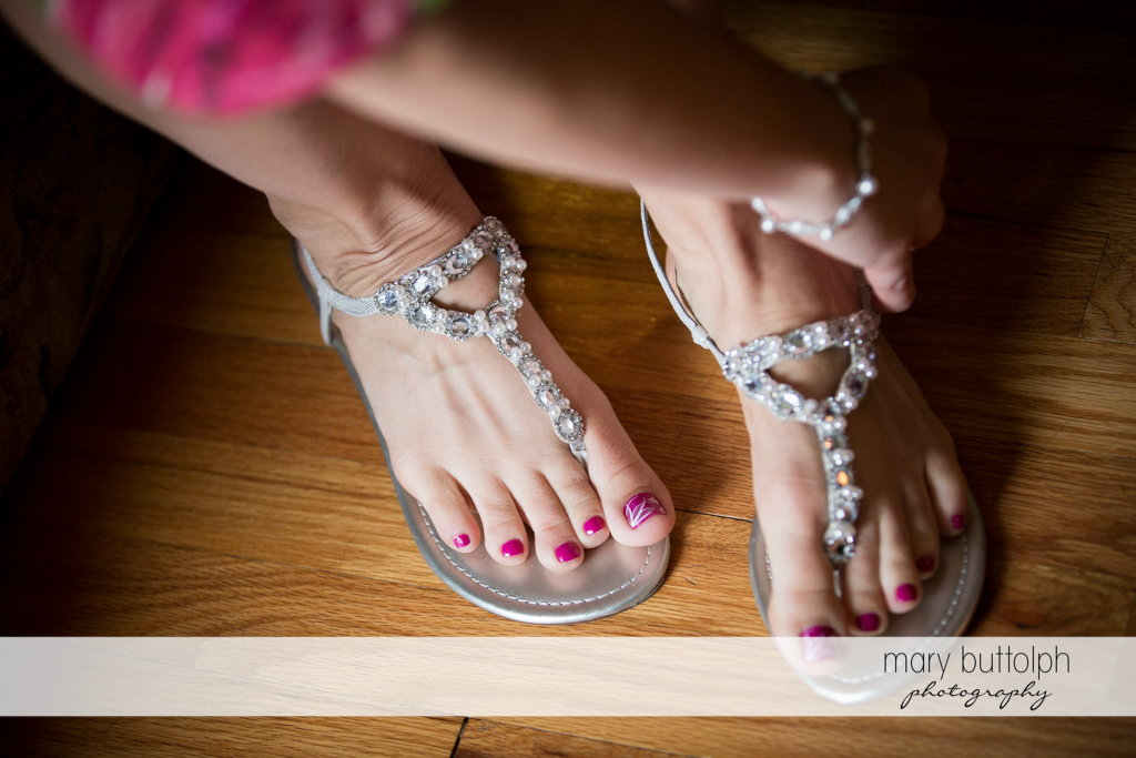 Bride puts on her wedding shoes at the Sherwood Inn Wedding