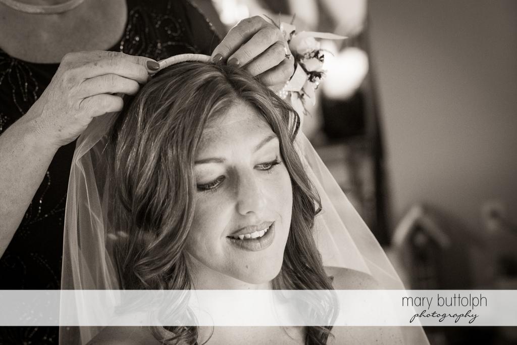 A friend puts on the bride's wedding veil at the Sherwood Inn Wedding