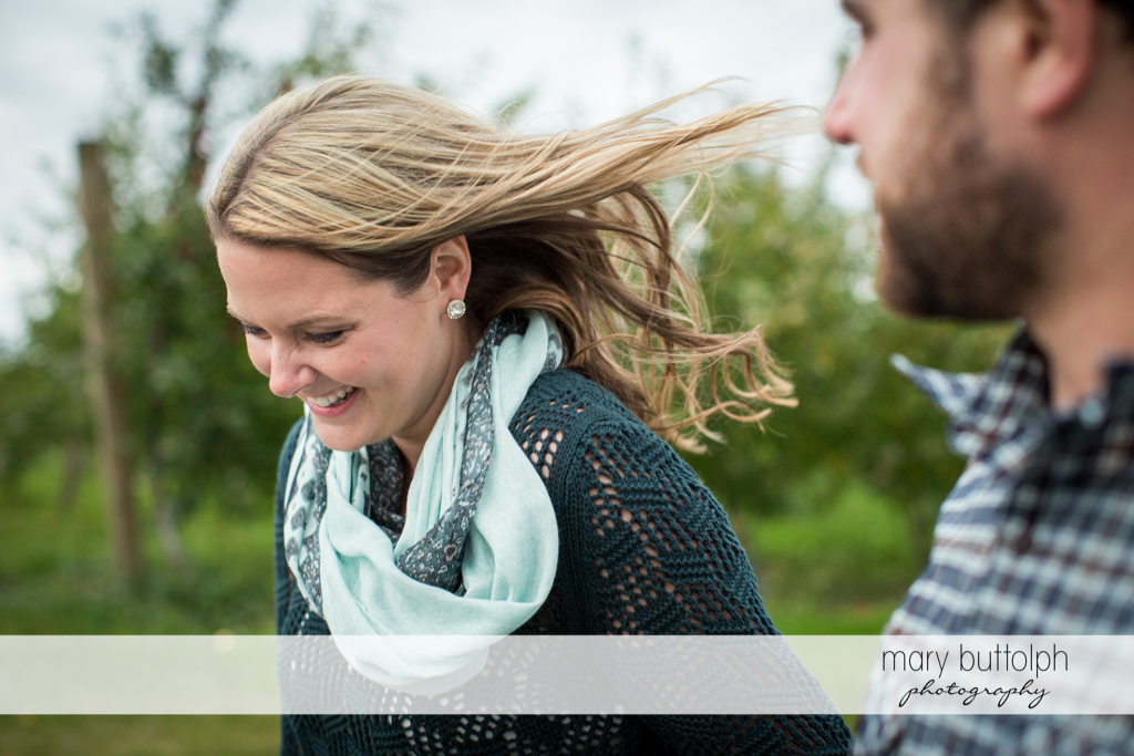 Couple enjoy the cool breeze in the garden at Beak & Skiff Apple Orchards Engagement