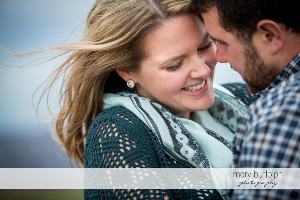 Couple in close up shot at Beak & Skiff Apple Orchards Engagement
