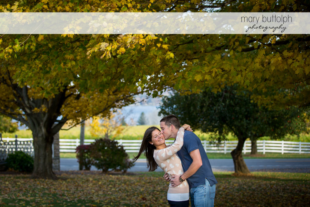 Couple express their love for each other in the garden at Skaneateles Lake Engagement