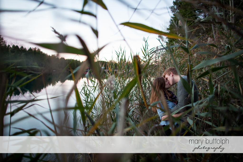 Couple show their affection by the lake at Green Lakes Engagement