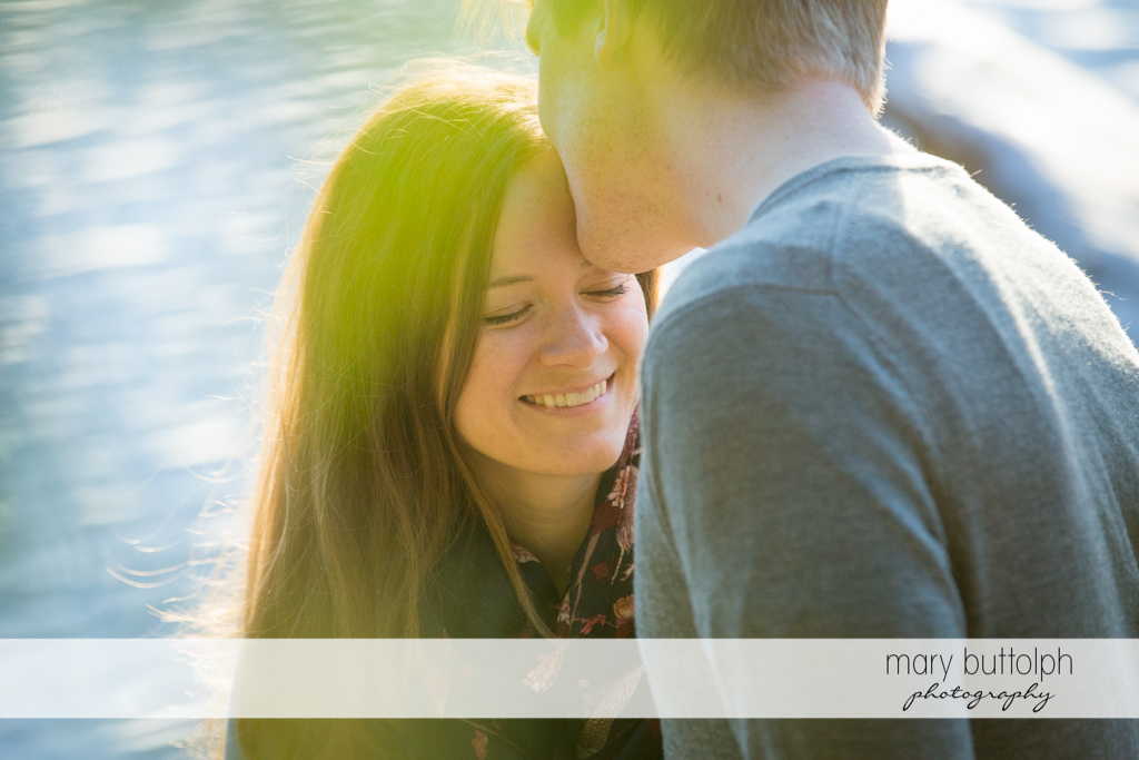Couple relax by the lake at Green Lakes Engagement