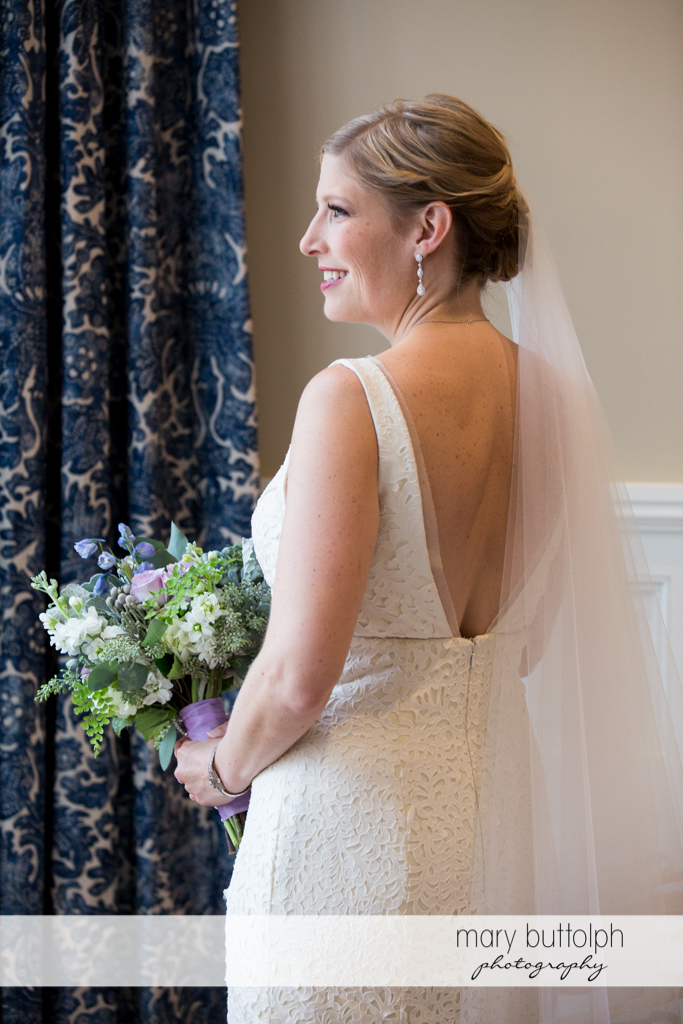 Medium shot of the bride holding a bouquet at Rowland House Wedding