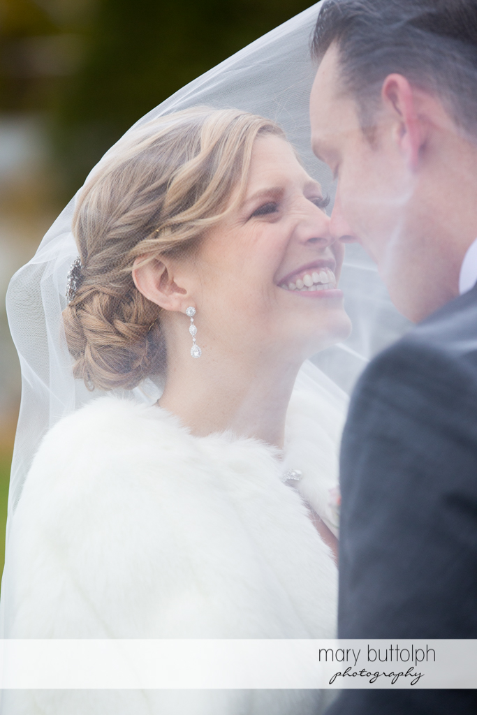Couple rub noses under the bride's veil at Rowland House Wedding