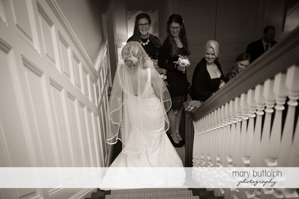 The bride and her bridesmaids go downstairs at Rowland House Wedding