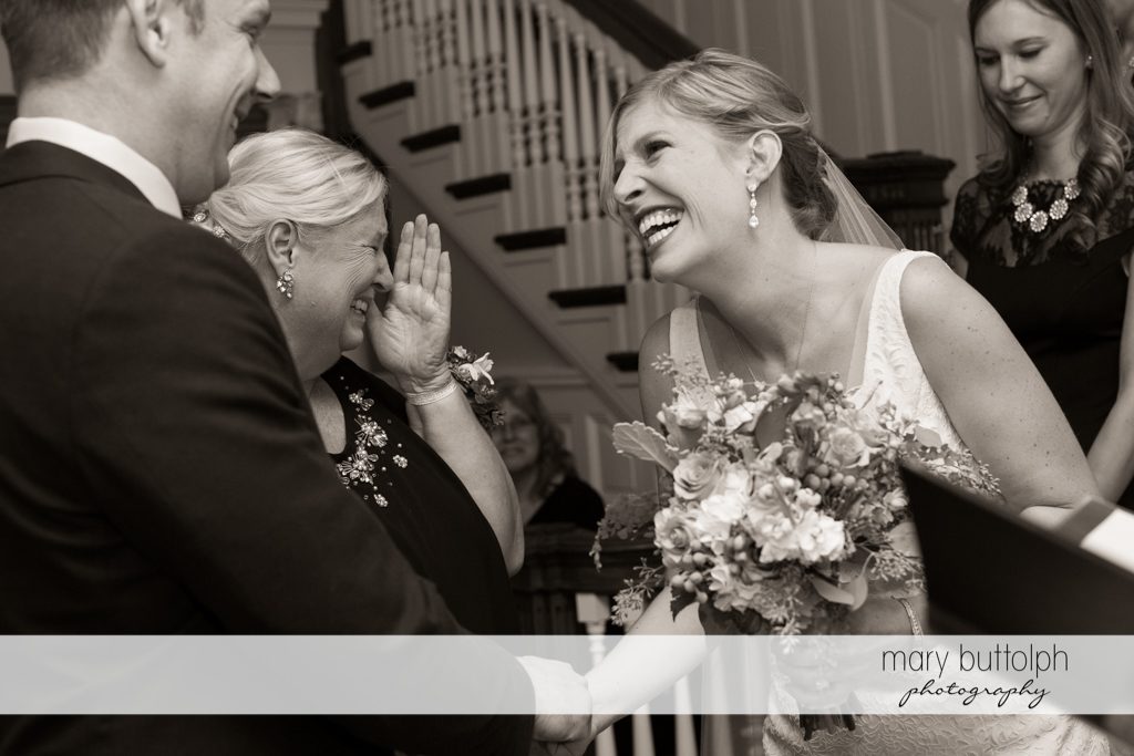 Couple share a happy moment with relatives at Rowland House Wedding