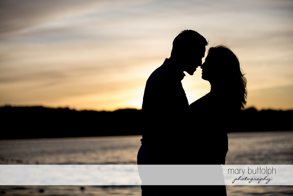 Couple share a romantic moment as the sun sets at Cazenovia Engagement