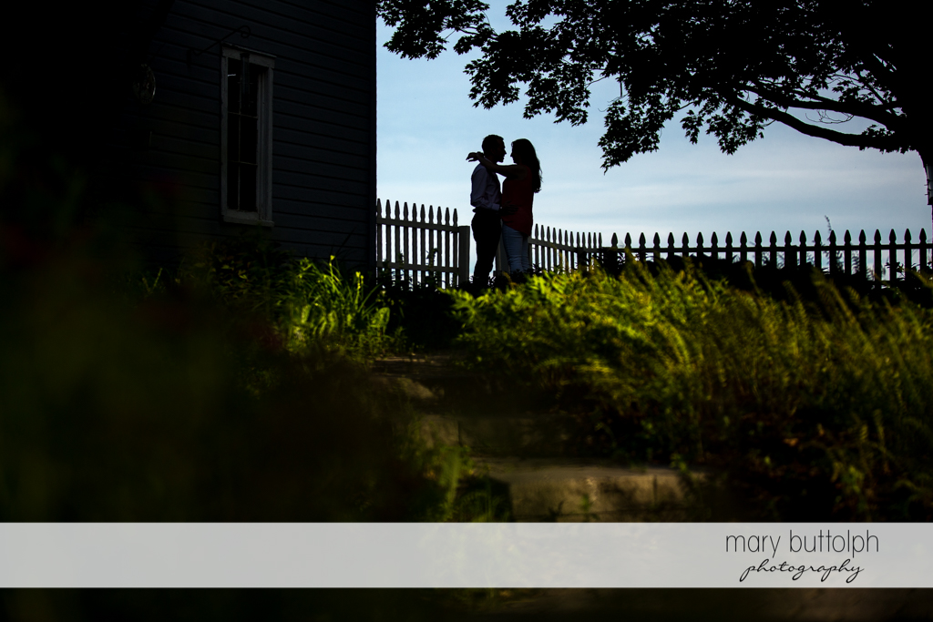 Couple hug as the sun sets at Cazenovia Engagement