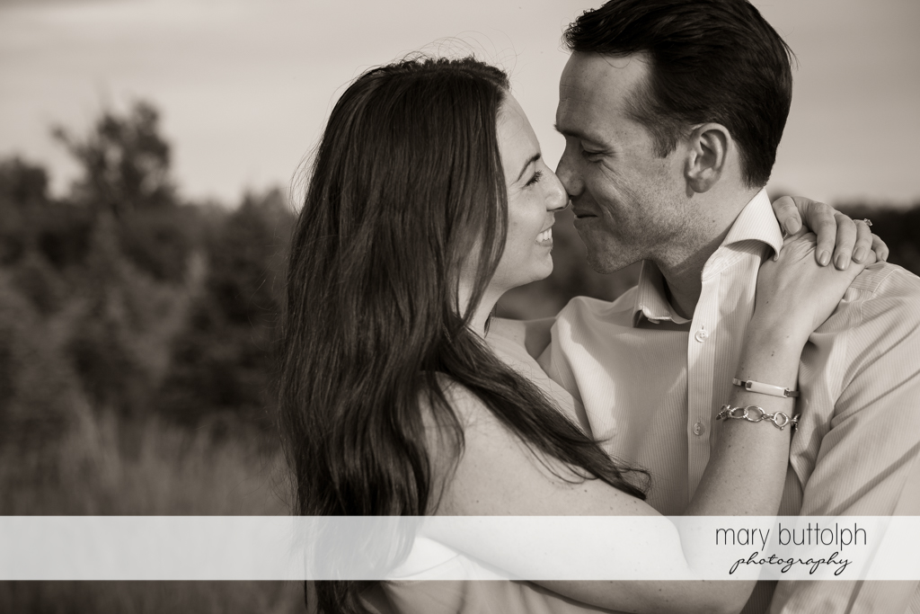 Couple strike a pose in the garden at Cazenovia Engagement