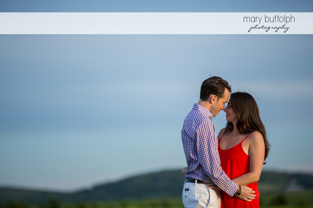 Couple pose in the garden overlooking the lake at Cazenovia Engagement