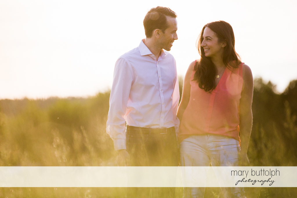 Couple stroll in the park at Cazenovia Engagement