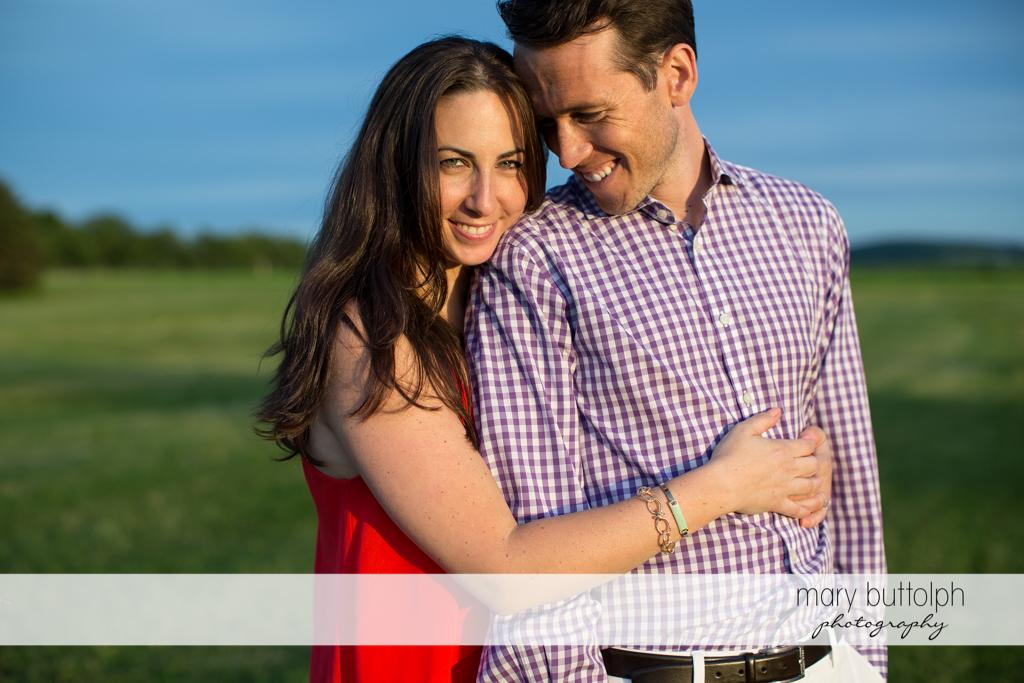 Couple enjoy the view near the lake at Cazenovia Engagement