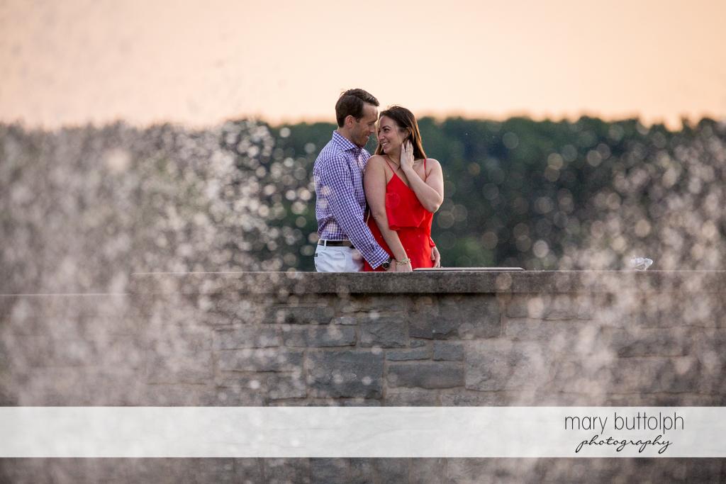 Couple stand on the brick bridge at Cazenovia Engagement