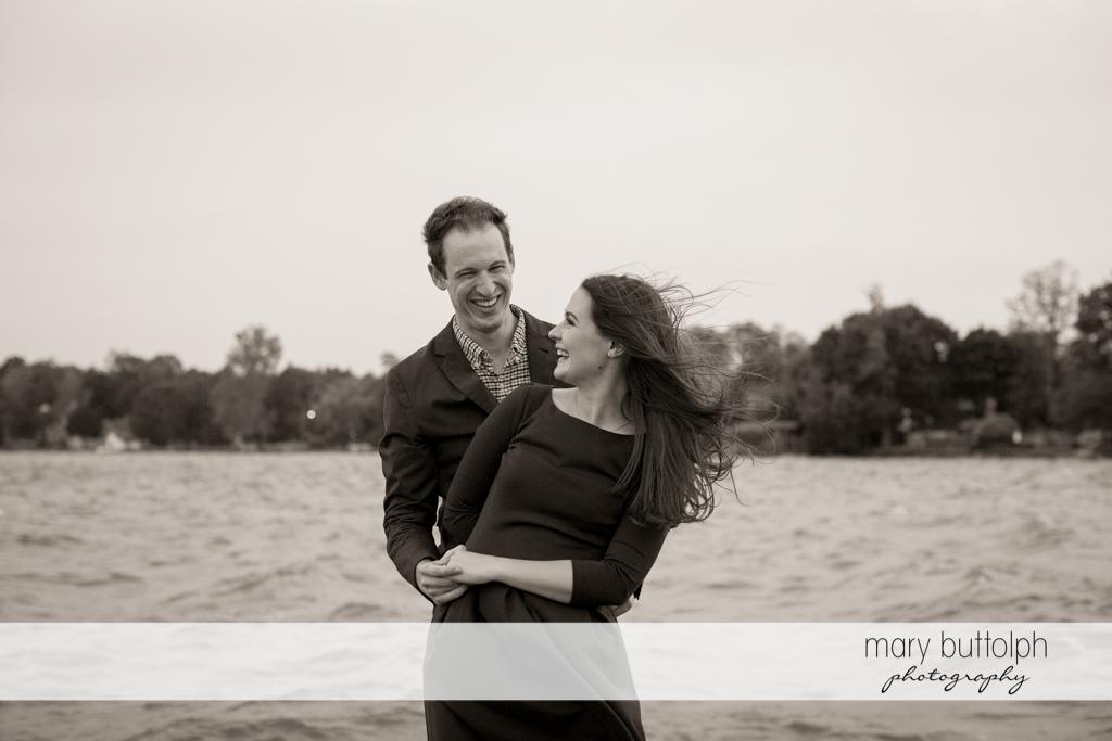 Couple take a break at the lake at Skaneateles Lake Engagement