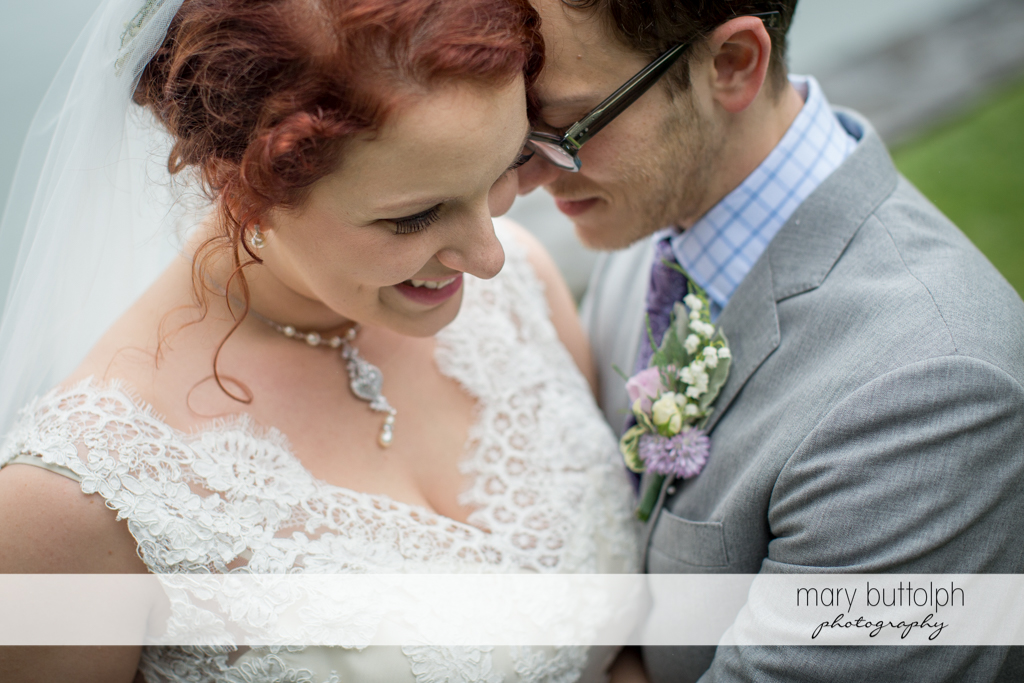 Couple share a tender moment at Frog Pond Bed & Breakfast Wedding