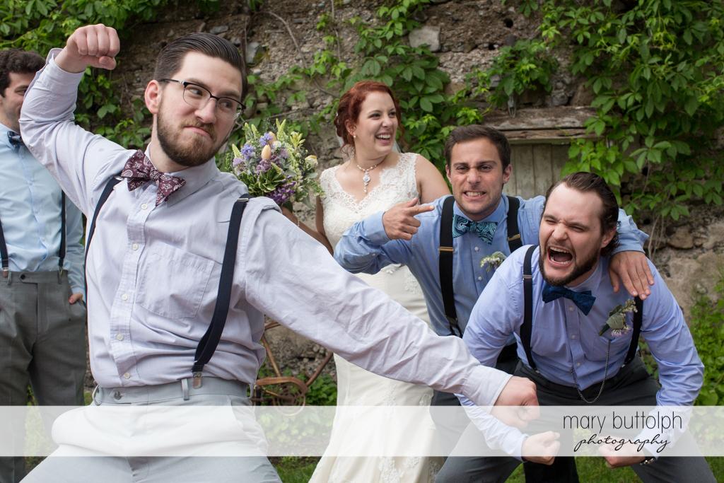 Groomsman clowns around at Frog Pond Bed & Breakfast Wedding