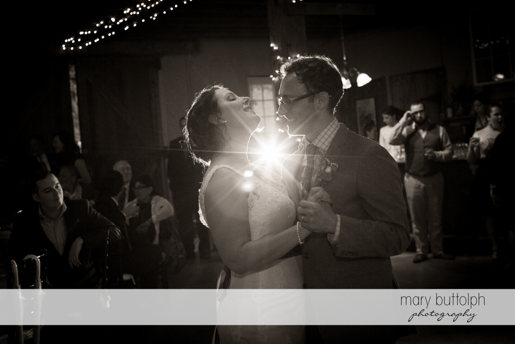 Couple in the spotlight as they dance at Frog Pond Bed & Breakfast Wedding